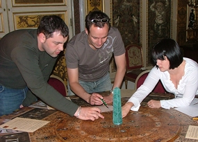 A team attempting to solve a puzzle during one of our Da Vinci Code indoor team building activities