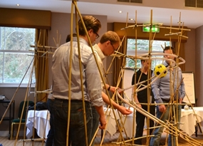 Team constructing a rollercoaster during one of our Rollercoaster indoor team building activities