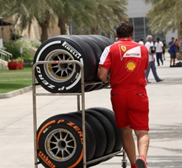 Mechanic pushing a trolley full of tyres at the F1 pre-season test