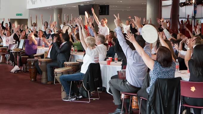 Conference delegates taking part in an energiser - how to keep conference delegates engaged