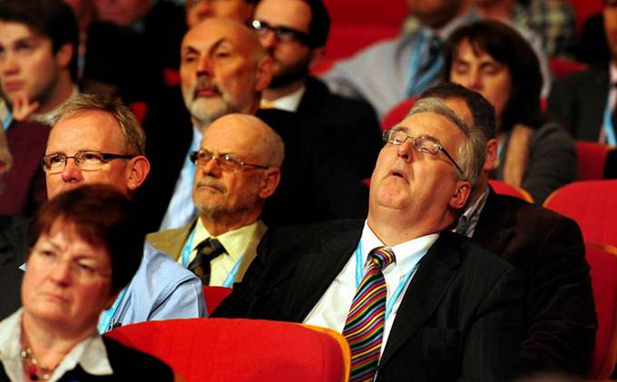 Man sleeping at a confenrece. How to keep conference delegates engaged.