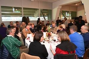 Guests socialising and talking in the Obolensky Restaurant at Twickenham during a autumn international hospitality event