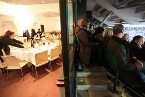 Split view of the inside of the Wakefield Restaurant and match seats as part of an autumn international hospitality package