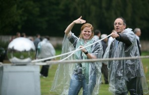 a pair of colleagues attempting to complete a crystal maze challenge in the wet
