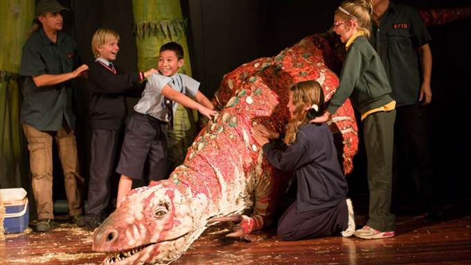 Children stood around a fake dinosaur - how to keep conference delegates engaged
