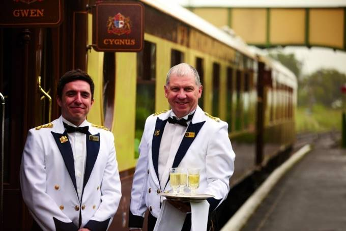 Stewards waiting to greet guests and welcome them aboard the British Pullman