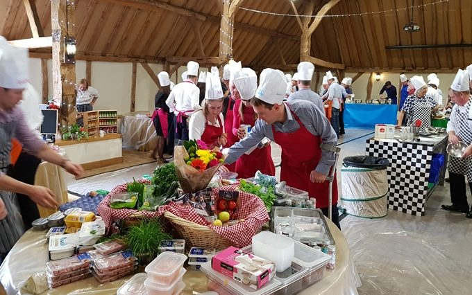 Team members gathering various ingrediants from the 'mini market' during a baking team building event.