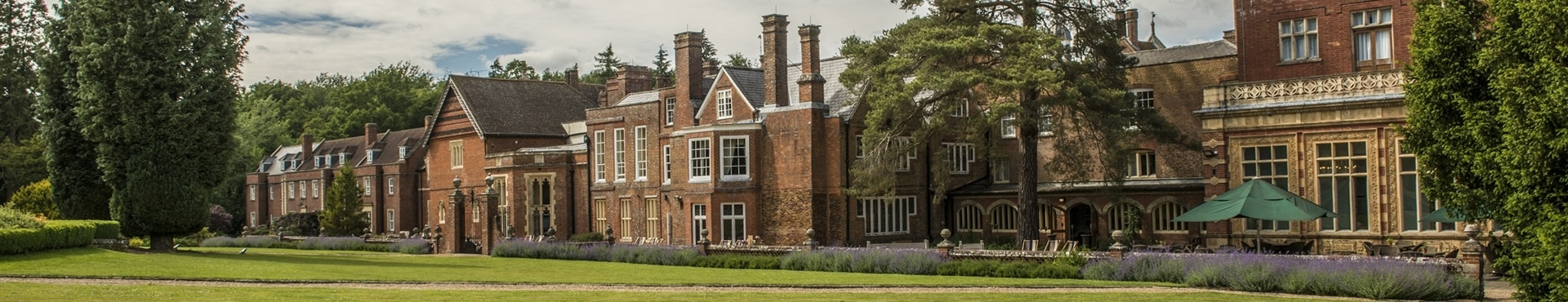 A landscape phot of an old manison house which is now a corporate away day venue.