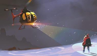 Helicopter in the snow with a search light highlighting a stranded person.