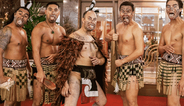 Five Maori Masters performaing the Haka in traditional dress